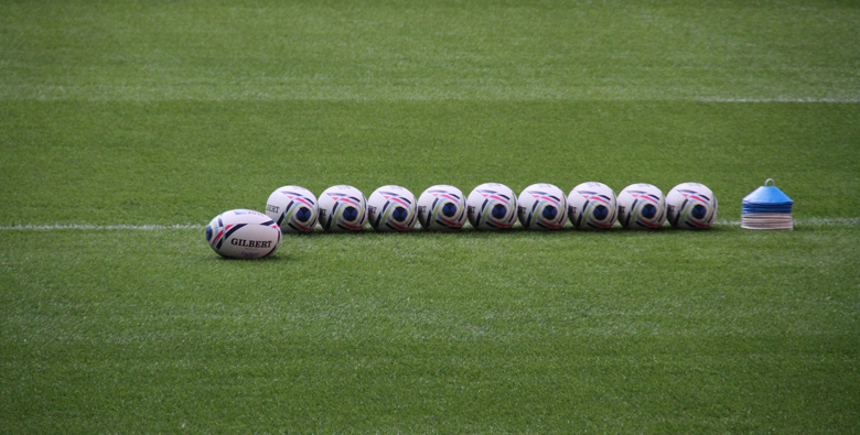 Rugby balls lined up